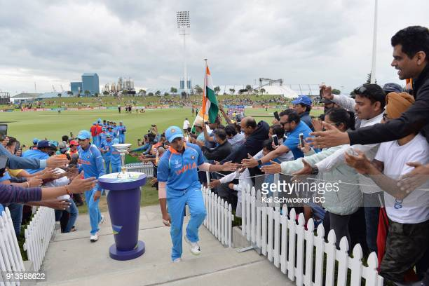Captain Prithvi Shaw of India walks past the trophy as he greets fans while he walks from the ground at the dinner break during the ICC U19 Cricket...