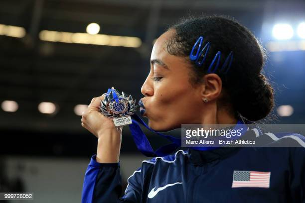 Captain Queen Harrison kisses her medal as Team USA celebrate victory during day two of the Athletics World Cup London at the London Stadium on July...