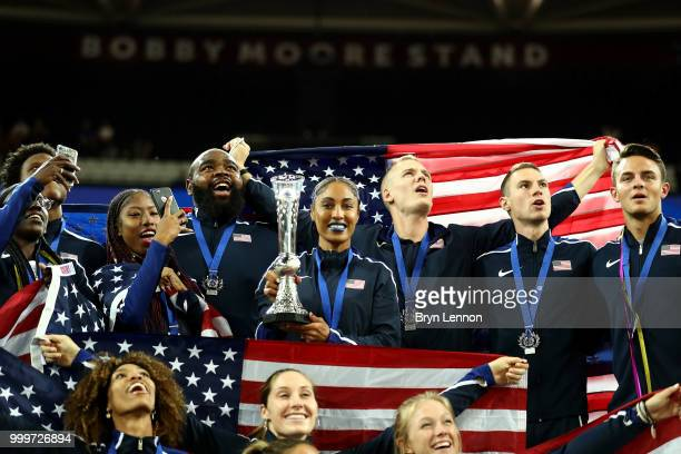 Captain Queen Harrison lifts the trophy as Team USA celebrate victory during day two of the Athletics World Cup London at the London Stadium on July...