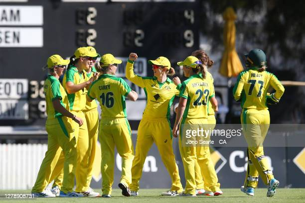 Captain Rachael Haynes of Australia celebrates a wicket with team mates during game three of the Women's One Day International series between...