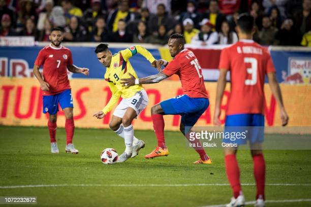 Captain Radamel Falcao of Colombia tries to get away from Kendall Waston of Costa Rica during the International Friendly match between Columbia and...
