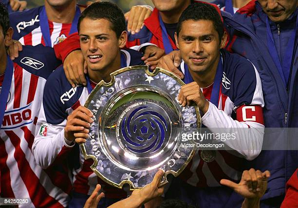 Captain Ramon Morales and Javier Hernandez of CD Chivas de Guadalajara hold up the InterLiga trophy for a photo after defeating Morelia 4-2 on...