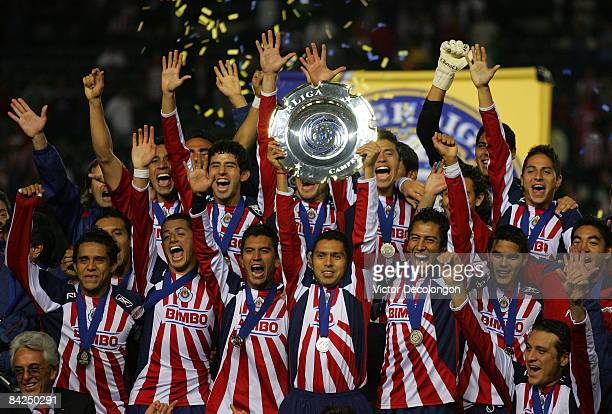 Captain Ramon Morales of CD Chivas de Guadalajara holds up the InterLiga trophy after defeating Morelia 42 on penalty kicks after a 11 draw in...
