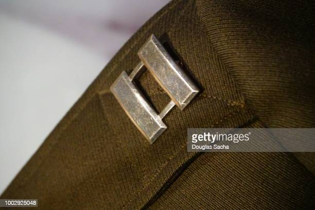 captain rank bars on a vintage army uniform - team captain stock pictures, royalty-free photos & images