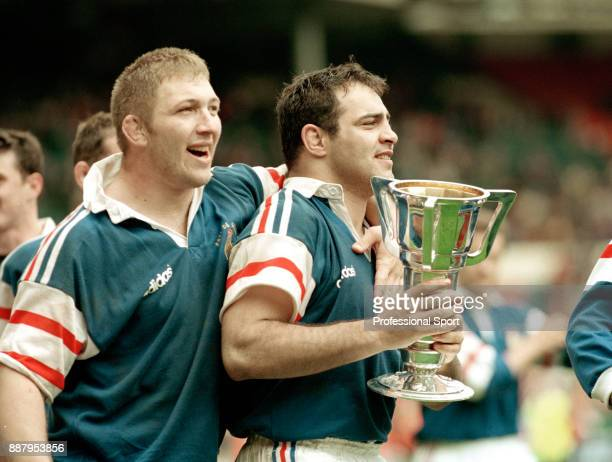 Captain Raphael Ibanez of France with the trophy after winning the Five Nations rugby union Grand Slam championship following their victory over...
