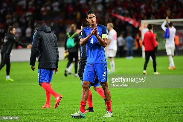 Captain Raphael Varane of France salutes the travelling fans following the 2018 FIFA World Cup qualifying match between Belarus and France at Borisov...