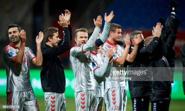 Captain Rasmus Wurtz of AaB Aalborg and hs team mates celebrate after the Danish Alka Superliga match between Lyngby BK and AaB Aalborg at Lyngby...