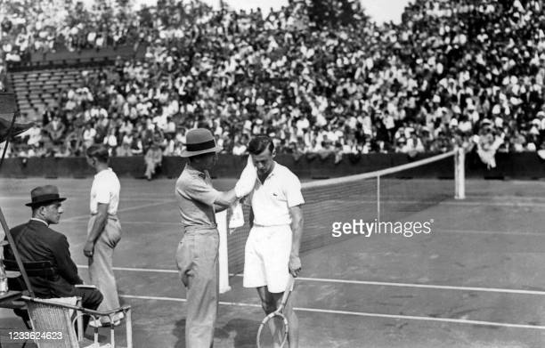 Captain René Lacoste dries French tennisman Christian Boussus's face during the Davis Cup in June 1935 in Wimbledon.