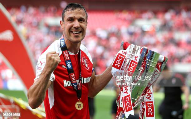 Captain Richard Wood of Rotherham United celebrates victory with the trophy after the Sky Bet League One Play Off Final between Rotherham United and...