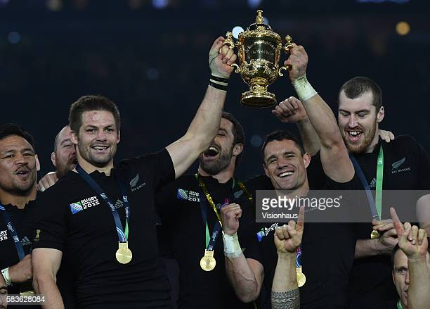 Captain Richie McCaw and Dan Carter lift the William Webb Ellis Cup as New Zealand win the 2015 Rugby World Cup Final between New Zealand and...