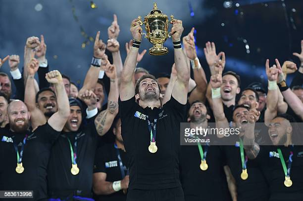 Captain Richie McCaw lifts the William Webb Ellis Cup as New Zealand win the 2015 Rugby World Cup Final between New Zealand and Australia at...