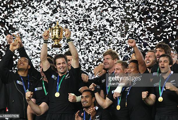 Captain Richie McCaw of the All Blacks lifts the Webb Ellis Cup after the 2011 IRB Rugby World Cup Final match between France and New Zealand at Eden...