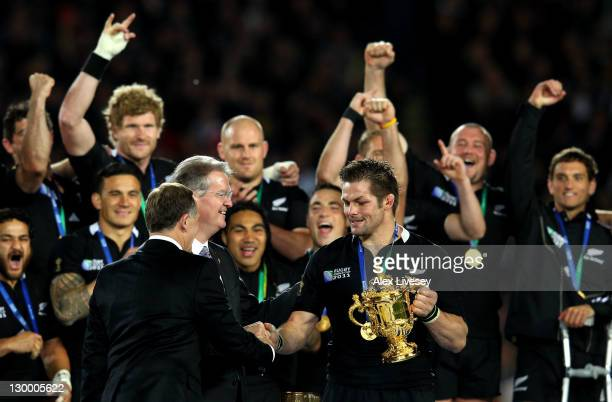 Captain Richie McCaw of the All Blacks receives the Webb Ellis Cup from IRB Chairman Bernard Lapasset after an 87 victory in during the 2011 IRB...
