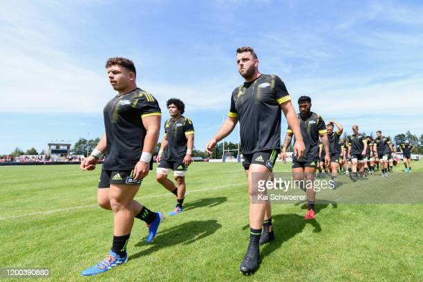 Captain Ricky Riccitelli of the Hurricanes and his team mates look on prior to the Super Rugby preseason match between the Crusaders and the...