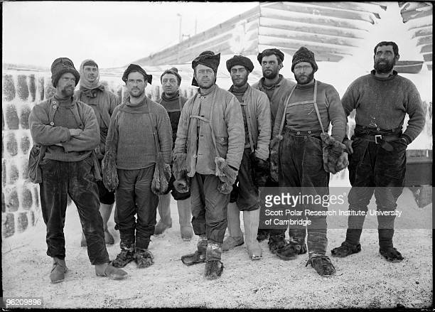 Captain Robert Falcon Scott and eight other expedition members at camp in the Ross Dependency of Antarctica during Scott's Terra Nova Expedition to...