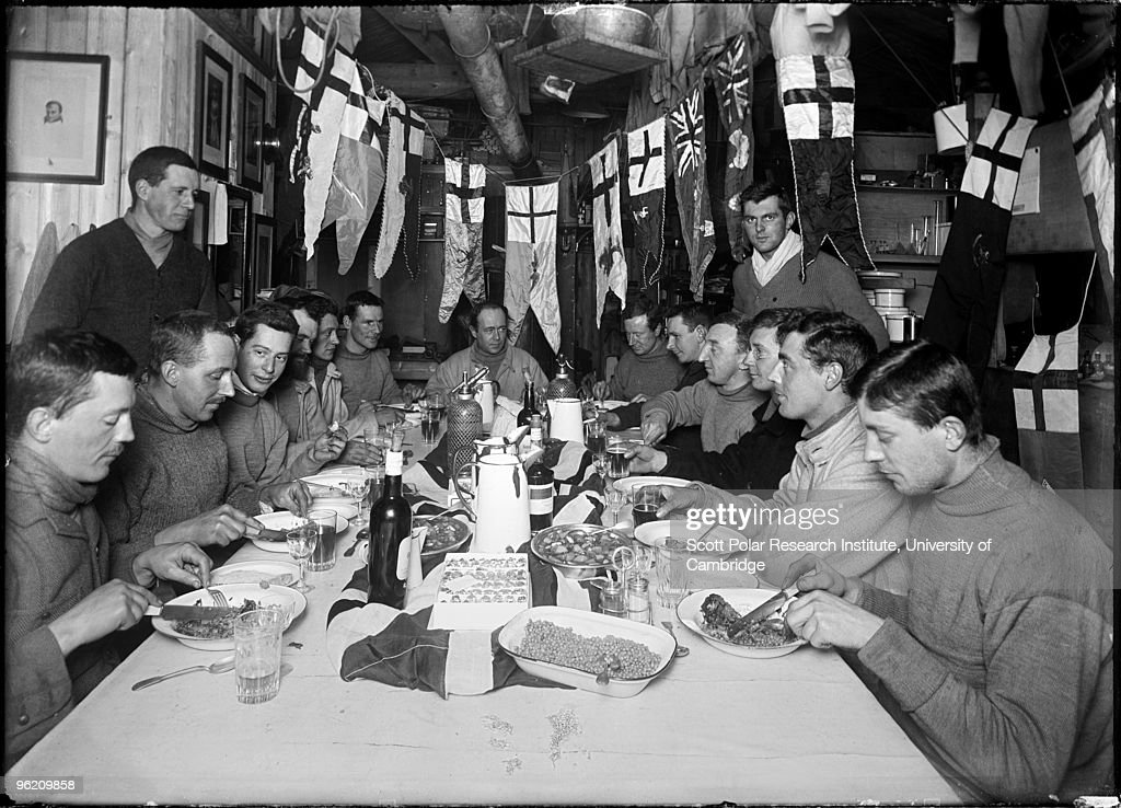 Captain Robert Falcon Scott (1868 - 1912) celebrates his 43rd birthday at camp in the Ross Dependency of Antarctica, during his Terra Nova Expedition to the Antarctic, 6th June 1911. Scott is at the head of the table.