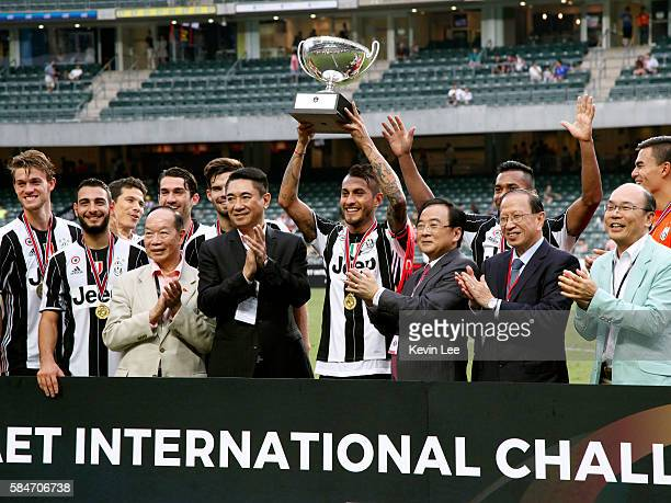 Captain Roberto Pereyra of Juventus FC holds the trophy after the match between Juventus FC and South China of Hong Kong at Hong Kong Stadium on July...