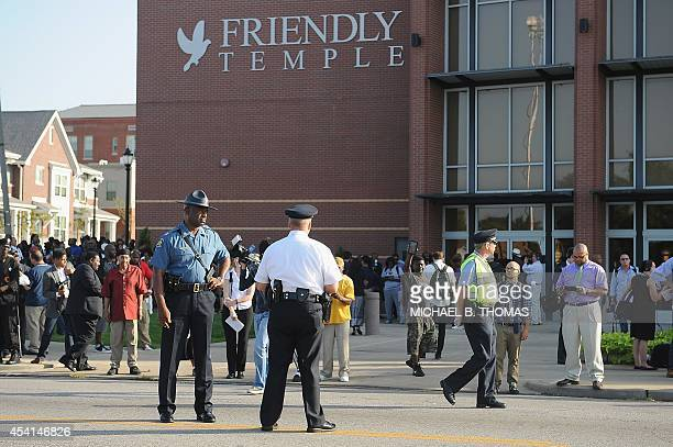 Captain Ronald Johnson of the Missouri Highway Patrol is seen outside the Friendly Temple Missionary Baptist Church before the funeral of slain...