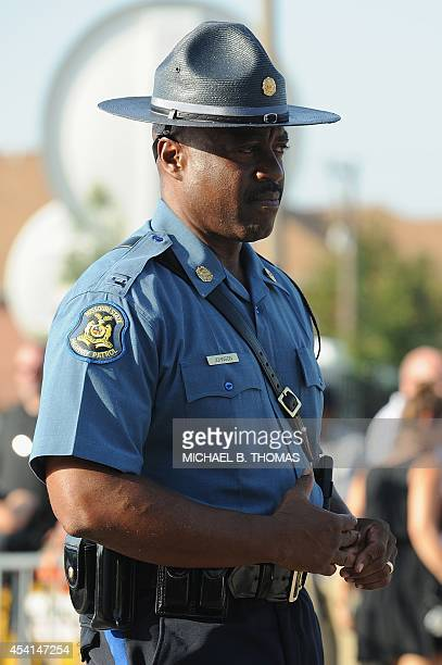 Captain Ronald Johnson of the MIssouri HIghway Patrol is seen prior to the funeral of slain 18year old teenager Michael Brown Jr at Friendly Temple...