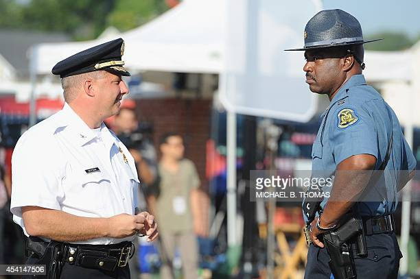 Captain Ronald Johnson of the MIssouri HIghway Patrol is seen with St Louis Poilce Chief Sam Dodson prior to the funeral of slain 18year old teenager...