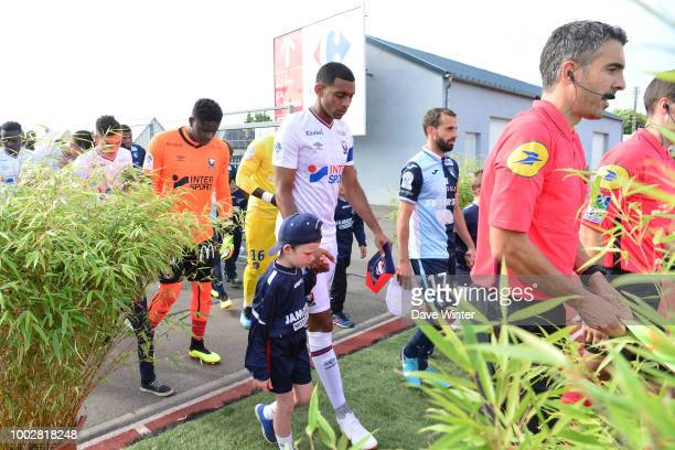 Captain Ronny Rodelin of Caen leads his team out for the preseason friendly match for the Trophee des Normands between Caen and Le Havre on July 20...