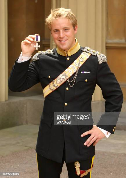 Captain Rowley Gregg of the Light Dragoons holds the Military Cross awarded to him by the Princess Royal at an investiture ceremony at Buckingham...