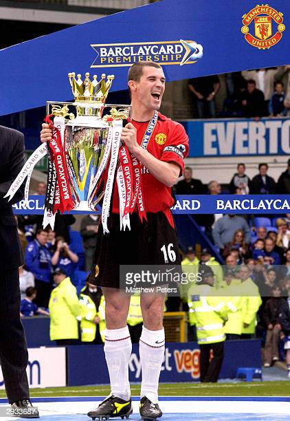Captain Roy Keane receives the Barclaycard Premiership trophy after the FA Barclaycard Premiership match between Everton v Manchester United at...