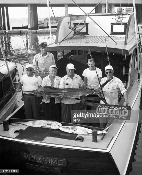 Captain Russ Kline poses with a group of anglers and a white marlin caught aboard the Welcome fishing boat in Ocean City Maryland circa 1950