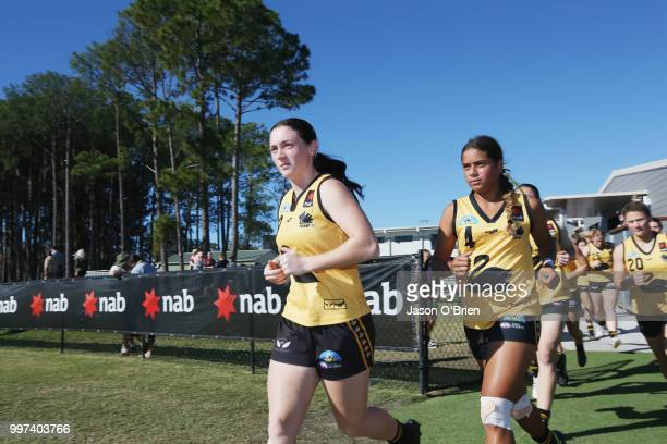 Captain Sabreena Duffy leads out her team during the AFLW U18 Championships match between Vic Country and Western Australia at Bond University on...