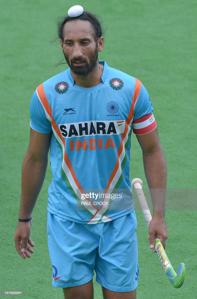 Captain Sadar Singh of India walks off the pitch after his team lost to Australia in the second semi-final at the men's Hockey Champions Trophy tournament in Melbourne on December 8, 2012. IMAGE STRICTLY RESTRICTED TO EDITORIAL USE - STRICTLY NO COMMERCIAL USE AFP PHOTO / Paul CROCK