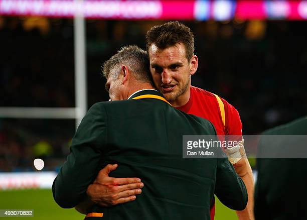 Captain Sam Warburton of Wales embraces Heyneke Meyer Head Coach of South Africa during the 2015 Rugby World Cup Quarter Final match between South...