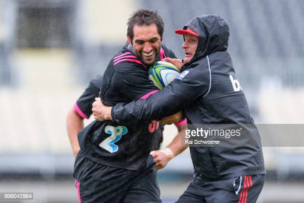 Captain Samuel Whitelock is tackled by Head Coach Scott Robertson during the Crusaders Super Rugby captain's run at AMI Stadium on March 22 2018 in...