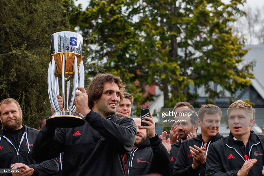 Captain Samuel Whitelock of the Crusaders lifts the Super Rugby trophy during a parade at Christchurch Art Gallery on August 8, 2017 in Christchurch, New Zealand. The Crusaders beat the Lions to win the 2017 Super Rugby Final on Saturday night in Johannesburg.