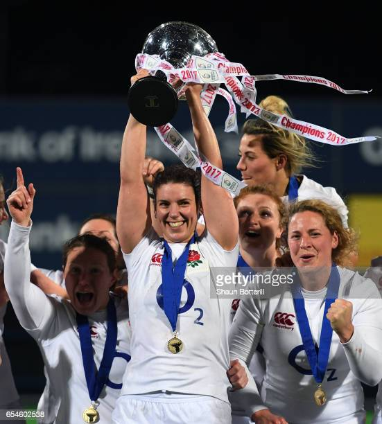 Captain Sarah Hunter of England and the England players celebrate with the trophy after winning the Grand Slam during the Women's Six Nations match...