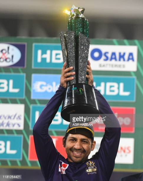 Captain Sarfraz Ahmed of Quetta Gladiators raises the wining trophy after the victory in the final of Twenty20 Pakistan Super League cricket match at...