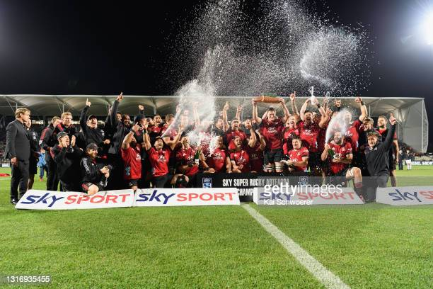 Captain Scott Barrett of the Crusaders and his team mates celebrate with the trophy after their win in the Super Rugby Aotearoa Final match between...
