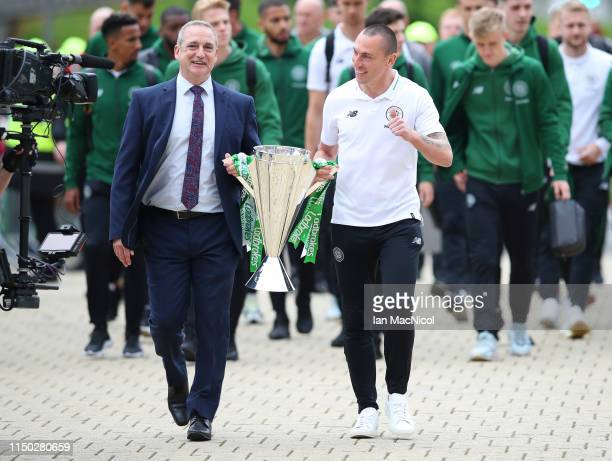 Captain Scott Brown of Celtic and explayer Paul McStay carry the league championship trophy to the stadium prior to the Ladbrokes Scottish...
