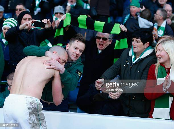 Captain Scott Brown of Celtic celebrates victory with the fans after the Scottish League Cup SemiFinal between Celtic and Rangers at Hampden Park on...