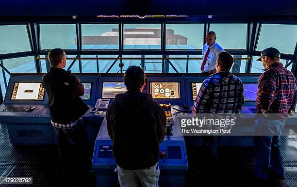 Captain Scott Conway class instructor and MITAGS Head of Navigation Systems and License Advancement Department talks to Deck Officer students Aaron...