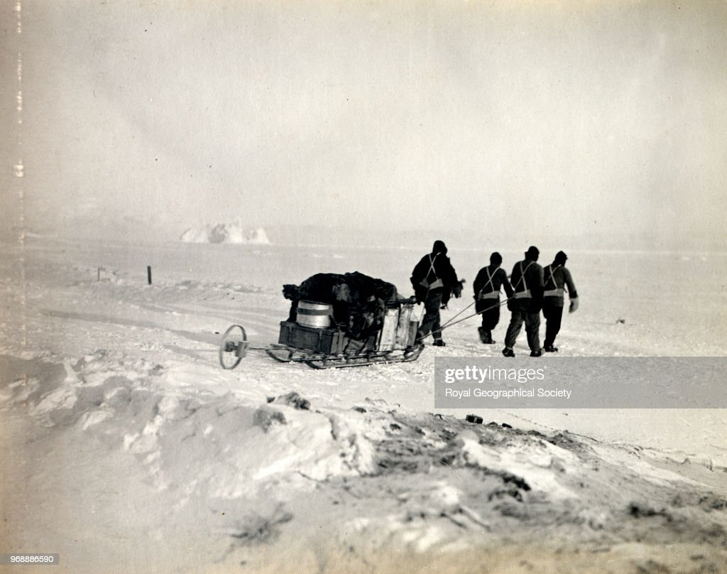 Captain Scott, Dr Simpson, Lieutenant Bowers and Evans leaving hut for the west, going on to sea ice, Antarctica, 15th September 1911. British Antarctic Expedition 1910-1913.