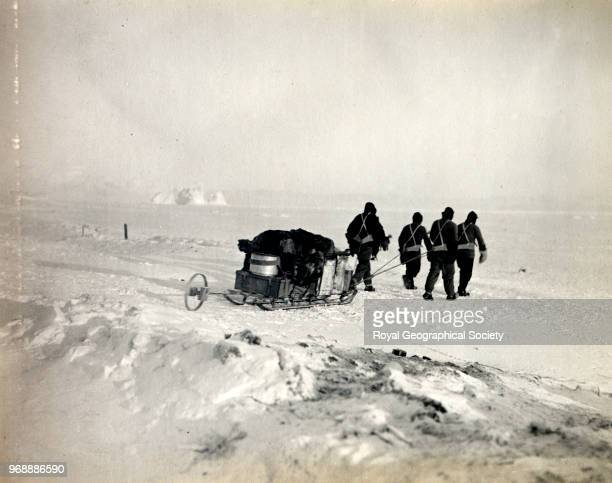 Captain Scott, Dr Simpson, Lieutenant Bowers and Evans leaving hut for the west, going on to sea ice, Antarctica, 15th September 1911. British...