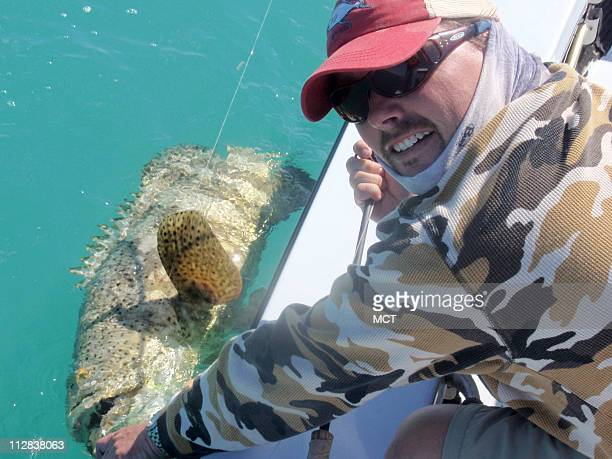 Captain Scott Irvine holds a 30pound Goliath grouper that was caught on a fly rod in Key West Florida
