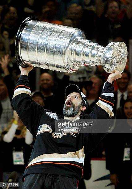 Captain Scott Niedermayer of the Anaheim Ducks hoists the Stanley Cup after his team's victory over the Ottawa Senators 62 during Game Five of the n...