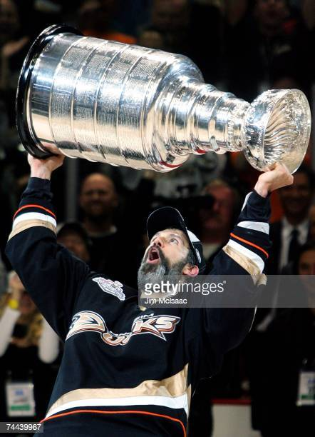 Captain Scott Niedermayer of the Anaheim Ducks hoists the Stanley Cup after his team's victory over the Ottawa Senators 63 during Game Five on June 6...