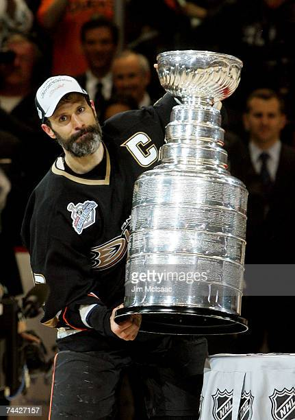 Captain Scott Niedermayer of the Anaheim Ducks lifts the Stanley Cup after his team's victory over the Ottawa Senators 62 during Game Five of the n...
