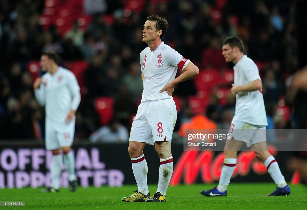 Captain Scott Parker of England shows his dejection next to team-mate James Milner after Arjen Robben of Netherlands scored their third goal in the international friendly match between England and Netherlands at Wembley Stadium on February 29, 2012 in London, England.