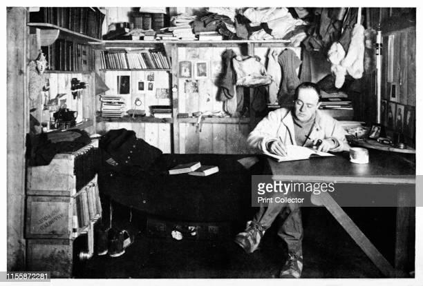 Captain Scott Writing Up His Journal', circa 1911, . British explorer Captain Robert Falcon Scott writing in his quarters at Cape Evans in...