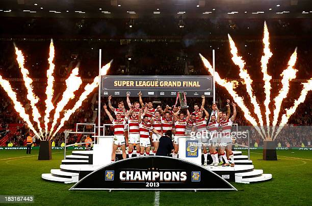 Captain Sean O'Loughlin of Wigan lifts the trophy following his team's 3016 victory during the Super League Grand Final between Warrington Wolves and...