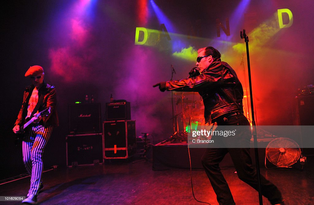 Captain Sensible and Dave Vanian of The Damned perform on stage at Shepherds Bush Empire on June 4, 2010 in London, England.