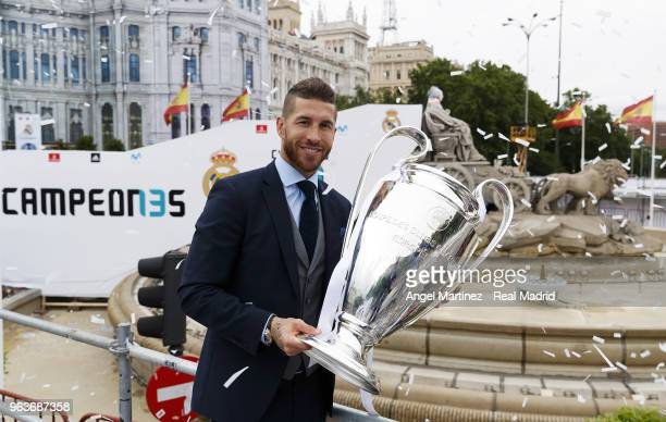 Captain Sergio Ramos of Real Madrid celebrates with the Champions League trophy at Cibeles Square a day after winning their 13th European Cup and...